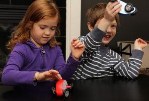 siblings-toys playing kids having fun